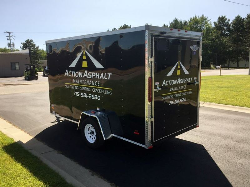 Action Asphalt Trailer Graphics Installation by D&L Signs